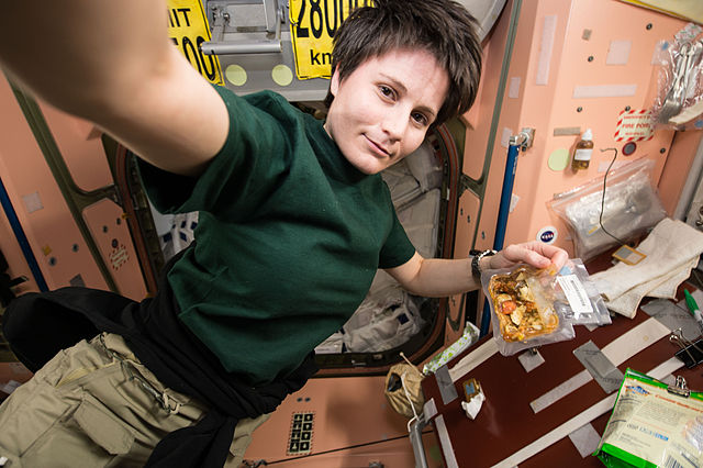 ISS-42_Samantha_Cristoforetti_prepares_to_eat_a_snack_in_the_Unity_node