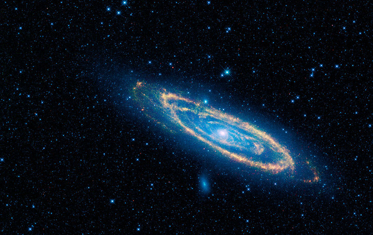 The immense Andromeda galaxy, also known as Messier 31 or simply M31, is captured in full in this new image from NASA's Wide-field Infrared Survey Explorer, or WISE. The mosaic covers an area equivalent to more than 100 full moons, or five degrees across
