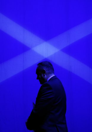 Scotland's First Minister Salmond leaves stage at SNP Spring Conference in Aberdeen, Scotland