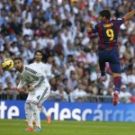 "Barcelona's Suarez heads the ball as Real Madrid's Ramos looks on during their Spanish first division ""Clasico"" soccer match at the Santiago Bernabeu stadium in Madrid"