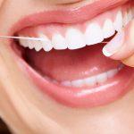 com utilitzar correctament el fil dental
